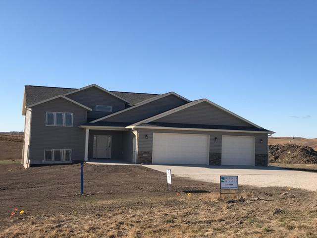 """Country living minutes from Bismarck. Beautiful new construction home sitting on 1.50 acres. Open floor concept kitchen and living room. 2 bedrooms on the main floor with a large master bedroom with a walk-in closet. Step out onto your 16 x 16 deck and enjoy your views. Walk downstairs to a big family room that includes a fireplace and wet bar and a walk out patio. 2 more bedrooms downstairs along with another bathroom. This is a must see property with a great floor plan. Be sure to check out the VIRTUAL TOUR with """"doll house"""" & floor plan views under the multimedia tab."""