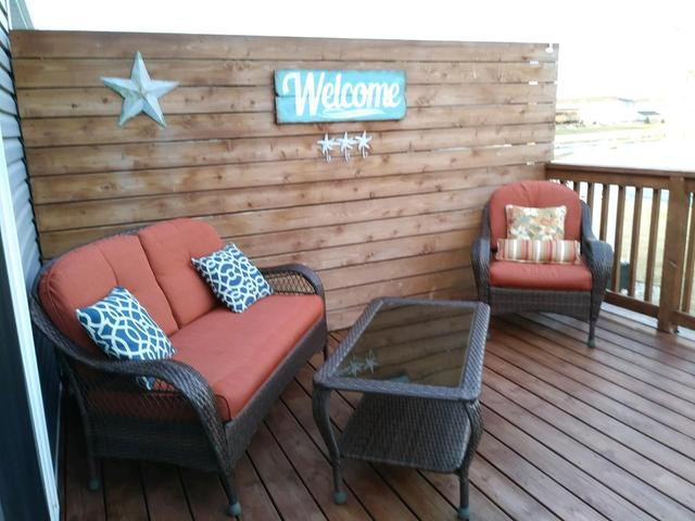Spring has finally arrived! Perfect timing to make this just like new 3 bedroom twinhome on the water your new home! It is just a short ride to the main channel. The main floor has vaulted ceilings and an open floor plan with beautiful views of the water! The SOFT CLOSE cabinets are enhanced with STAINLESS appliances, including a GAS range, a large pantry and GRANITE counters. The laundry room is conveniently located by the master bedroom. The master has a WALK-IN closet and a 3/4 bath. The basement has a family room with a GAS fireplace and a full bath with a JACUZZI tub and another bedroom. The deck is enclosed underneath for additional storage and there is an extra parking spot right by the front door. The sodded yard includes 46 ft of beach and you CAN HAVE A DOCK!