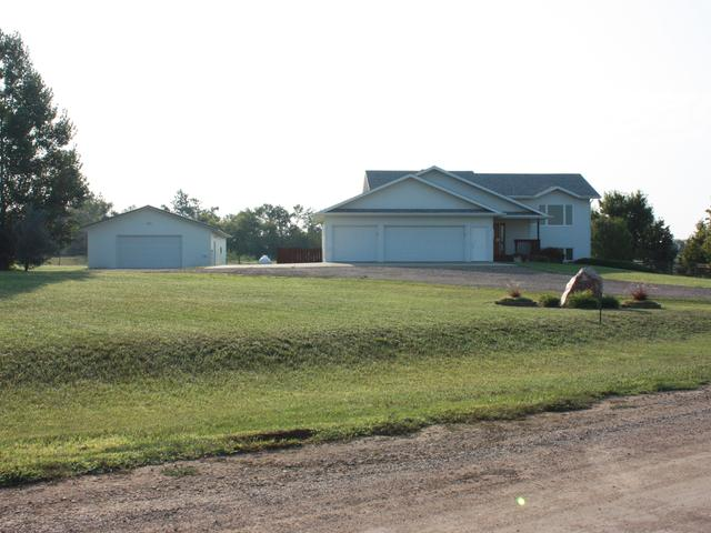 Less than 5 minutes from Bismarck! Custom built home with 4 large bedrooms and 3 bathrooms on nearly 3 acres with an additional 3+ acres available. Quiet setting and zoned for horses if you purchase the additional acres! Triple attached garage and 30X50 shop! Double concrete parking pad and dog kennel! MOVE IN READY!! NO SPECIALS! High efficient home with plenum heat system! Call your favorite agent today for a private showing!!