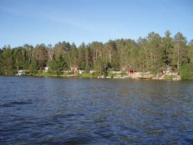 Haven't you always dreamed of owning your own resort? This year round resort consists of 4 cabins and a fully winterized main house and is nestled among 5.51 acres of mature pines and hardwoods. It is located on 421' of west facing swimming sand frontage on Pickerel Lake. This Northwoods' jewel of 736 acres remains mostly undeveloped and is known as a high quality fishery. The Northern Highland American Legion State Forest and thousands of acres of unspoiled wilderness are only a few steps away. The resort has pier spots for all, a great swimming beach, recreation room, fish cleaning house, volleyball and more. Each cabin comes fully furnished from coffee pot to fishing boat. Live the dream in the Northwoods!