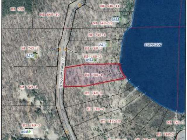 A lovely level sandy shoreline lot on 736 acre Squaw Lake. Excellent building site is awaiting your new lake home. Great fishing on this superior lake. Nice Privacy, by great location for ATV's and Snowmobiles. Near the Chequamegon National Forest.