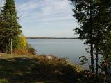 Here's a great 3.50 acre parcel of land facing east for those picturesque sunrises. Imagine yourself waking up and having your morning coffee on the deck of your dream home overlooking your 334' of frontage for your family's pleasure. The area is quiet and peaceful with great fishing and boating activities. Along with water excitement you have ATV and Snowmobile trails and Ski slopes at your fingertips to keep you busy year round. Get your building plans together and start your life up north today.