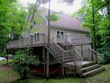Sit on your huge wrap around deck and enjoy the panoramic views of Little Long Lake. You will love the peace, quiet and back to nature feeling you get with this property located in the middle of the Chequamegon Nicolet National Forest. The seven year old chalet home has one hundred twenty feet of sand swim lake frontage for the family to enjoy. You can use this beautiful home year around as there are snowmobile & ATV trails in the immediate area. Snuggle up next to the fireplace in the open concept great room. Upstairs you will find a private master suite with full bath and sitting area The walkout lower level rec room is all finished except for a a ceiling. A drive under garage provides plenty of storage for the boats & water toys.
