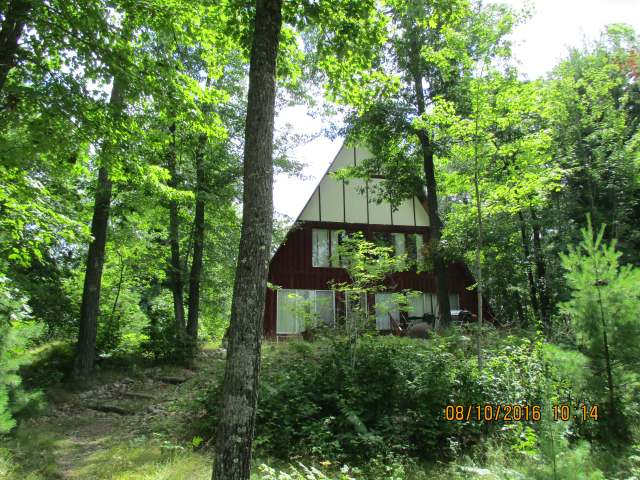 15 Acre parcel with older A-Frame. 4BR, 2 1/2 BA Home is in need of some TLC. Nice wooded parcel that is zoned Rural residential. This property can be subdivided into 100' lots. Close to town, Great Privacy, 35'deep lake.