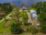 This property includes a 3 bed, 2.5 bath home built in 2000, a 36 x 63 Pole building with a heated workshop & a 24 x 54 storage shed, & detached 2 car garage. Located on Pelican Lake with 3585 acres of water. The lot has 239 ft. of frontage with 2.45 acres of land with 20 x 40 ft. fenced in garden & western exposure for the most spectacular sunset. The home includes an oak kitchen with plenty of cabinets, a breakfast bar & dining room with patio door to backyard patio. The living room is lakeside with gas fireplace, vaulted ceiling, & patio door to the 40 x 14 ft. lake side deck. The master bedroom also has a patio door to the lakeside deck, walk in closet and private bath with separate whirlpool tub and shower. The main floor also includes a laundry room & half bath. The walk out lower level has two bedrooms, full bath, & cedar closet. This property has a boat landing, landscaped rock walls, perennial flower gardens, sprinkler system, fire pit area, & dog kennel.
