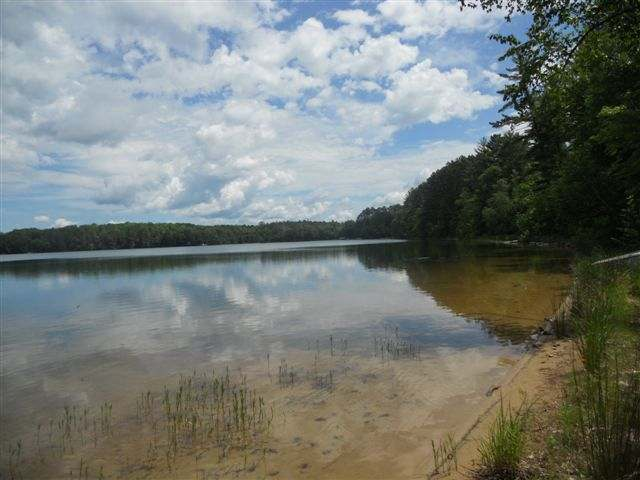 FINGER LAKE LOT - Fantastic building site close to Eagle River. Level wooded .91 acre lot with 300 ft of sandy frontage and a gradual beach perfect for swimming. Finger lake is peaceful, clean and great for fishing. The view is spectacular and would make a perfect building site for your home or cabin. Family owned for many years and is now offered for sale. Get your plans and bring your contractor today!