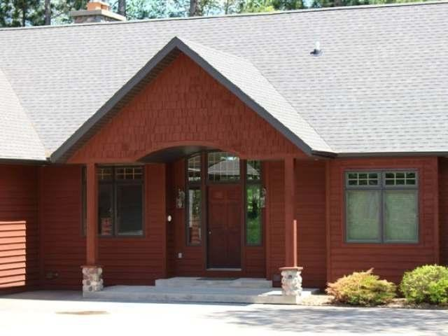 Bring the family and friends because there is room for all! This Cedar sided home features 5000 square feet and 3+ bedrooms, 5 baths. This executive retreat is situated on a wooded lot with 230' of water frontage offering great privacy on a 500+ acre lake. Main floor features great room with spectacular windows showcasing expansive lake views, gorgeous two-way stone fireplace between great room and dining, well appointed kitchen with new stainless appliances, built in ovens, gas cook-top and extensive granite surfaces, sunroom, laundry room, master suite with his' n her granite topped vanities, whirlpool tub and shower. The finished, walk-out lower level features a family room with massive stone FP, 2 bedrooms, 2 baths, bonus room, den and play room. Loft bunkroom suite with bath. Professionally landscaped steps and fire-pit area, permanent floating pier, circle drive and att. 3 car garage. Swimming, fishing, boating, snowmobiling, you name it! The ideal Northwood's retreat.
