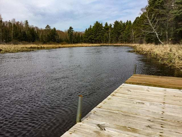 Privacy, seclusion and a true wilderness experience is yours on this affordable 7+ acre riverfront parcel with 935' of frontage on the Trout River. Driveway, driven point well, gate, patio, pier,and electric power pole are all in place. A perfect place to build your wilderness retreat or just set up your RV. Older camper on site is not usable wihtout major work and seller can remove it at buyer's discretion. Or, this is a great place to start building the ultimate Northwoods retreat. Most of the work is already done and this beautiful retreat is ready to enjoy now. You won't find a more private place anywhere in the Northwoods at this price that's already equipped with on-site well and electricity. Close by there's hundreds of lakes, shopping, casino, and unlimited recreational opportunities.