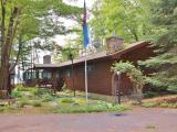 HORSEHEAD LAKE HOME. MOTIVATED SELLER! There's nothing more to want! This property has an almost level approach to 220' of sandy lake frontage, 3 BR, 2 BA, huge master suite with gas fireplace, great room with vaulted ceiling, stone fireplace and knotty pine, a 4 season glass sunroom, office, 2-car garage, snowmobile shed, garden shed, workshop, woodshed, and a lakeside gazebo. Custom additions by Mike Winter Construction, newer roof, siding and windows. Lots of Northwood's ambience with knotty pine, vaulted ceilings and stonework. Beautifully landscaped lot offers perennials and loads of privacy. There's nothing more you need! Bring the family and toys and begin a legacy of Northwood's memories. Horsehead Lake is conveniently located between Minocqua and Rhinelander surrounded by State Forest Lands, miles of groomed snowmobile trails, bike trails and hiking trails.