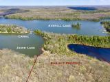 This is very unique lot on the Presque Isle Lake Chain with 1,189 feet of frontage and 13.15 acres on both Averill and Jamie Lake for under $200,000! The property sits on a peninsula with a man-made canal connecting little Jamie Lake to the rest of the Presque Isle Lake Chain, an irreplaceable feature that DNR no longer permits. The smaller Jamie Lake would be a great spot to shield boats and other water toys away from wind behind the peninsula. There are several building sites with great views of Averill Lake, it backs up to the Hemlock Trail, and it's zoned Recreational, allowing weekly rentals. This property also includes 647 feet on a small pond on the backside of the parcel. Come see it today!