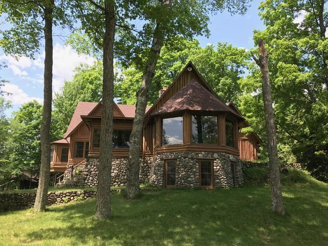 Here's an once-in-a-lifetime opportunity to purchase an island estate with mainland home on the beautiful 1309 acre Squirrel Lake in Minocqua. This property includes over 2000 feet of sand frontage and 5 acres on the iconic 66-acre Squirrel Lake Island. It offers a fully log-sided 8BR, 6BA 1929 yesteryear home that boasts over 5100 sqft. There's also a two-story, three-slip wet boathouse with living quarters, and an additional 3,200 sqft entertainment venue with a wet bar, bowling alley, pool table, dart boards, fieldstone fireplace and wrap-around screen porch. On the shore there is a remodeled four-season 2BR, 1 BA home on 4.4 acres, a boat storage building and five boat slips. Recent improvements include a new driven well and kitchen appliances in the main island home and new roofs on all the structures. This is the only property like this available anywhere, so make an appointment to see the ultimate island retreat today!