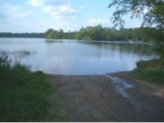 White Feather Woods Lot 9: Reasonably priced wooded lot to build a home or cottage with deeded access to Fence Lake Chain. Electricity and protected covenants for White Feather Woods subdivision. Broker Owned