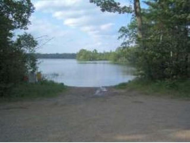 White Feather Woods Lot 4: Reasonably priced wooded lot to build a home or cottage with deeded access to Fence Lake Chain. Electricity and protected covenants for White Feather Woods subdivision. Broker owned.