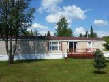 Here's a very well maintained mobile home with a back yard shed and 2 stall detached garage. This has a split bedroom design with a master bath that is awesome - from the whirlpool tub walk-in shower very nicely done. Washer & dryer are by the entry then you walk into a beautiful kitchen and dining area that flows into a huge living room with fireplace then a full bath and second bedroom. Very well maintained, like new.