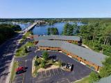 "Minocqua Lake Condo! Exceptionally located with a 2 minute walk over the bridge to downtown is convenience at it's best. Walk into town with the family to enjoy dinner and the Min-Aqua Bat Waterski Show! Very spacious 3 BR, 1.5 BA and has 3 floors of living space covering ~2900 sq ft. Upon walking inside you will be greeted by an open concept design done tastefully with Northwoods charm throughout. It comes fully furnished by local furniture store ""Roughing it in Style"" with all custom log furniture and leather seating. There are 3 BR upstairs and additional bunks in the lower level. The lower level has been recently finished featuring a spacious rec room with pool and poker table. The pier/dock slips are shared by all tenants as is the 170' of sandy swimming frontage. This property has potential income producing rental ability &. This is a great opportunity to enjoy the Minocqua Chain living at a much lower cost with carefree maintenance! Located on Snowmobile Trail!"