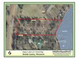 Beautiful Squaw Lake Lot. .87 acres with great views. This lot resides in an area of new quality homes. There is 119' of beautiful sand frontage. Squaw lake is 785 acres and sought after by many. Wonderful place to build your Northwoods Retreat.
