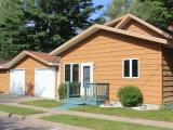 Located on the Island of Minocqua is this charming turn -key ready home. With the perfect mix of hardwoods and tile this home has all the Northwood's charm you could ask for. Walking distance from downtown Minocqua, this home is zoned general business leaving you with endless options. It has an oversized, two car insulated and heated attached garage, extra-large sun deck with a separate hot tub area and a landscaped back yard to maximize your privacy. The home offers a new addition with your spacious kitchen and plenty of area for entertaining, main floor master bedroom and laundry. Upstairs has two additional bedrooms and a full bath. Downstairs is partially finished with an extra rec room and half bath. This home supports all your needs being located in the heart of Minocqua .
