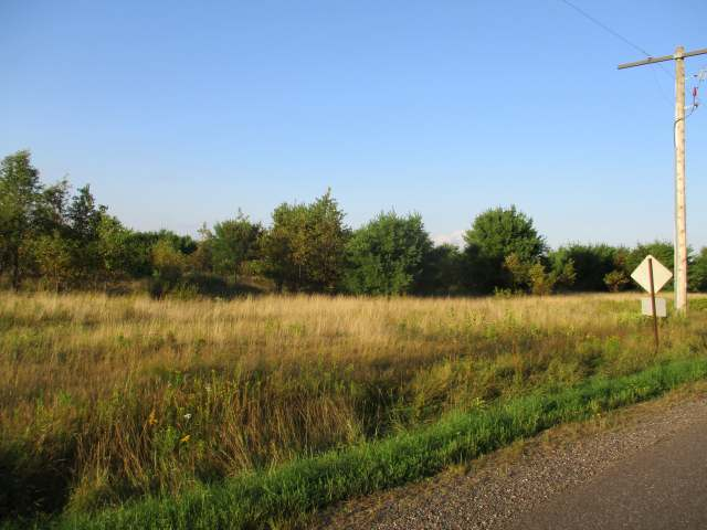 "Here's a vacant lot just under 5 acres. This lot adjoins a trailer campground parcel just down from the old ""Why Not Here"" now known as the Habit. Here's your chance to get a place in the north and the adjoining property is also for sale called Green Acres. Buy both get a deal and let the park pay for it all. Call today."