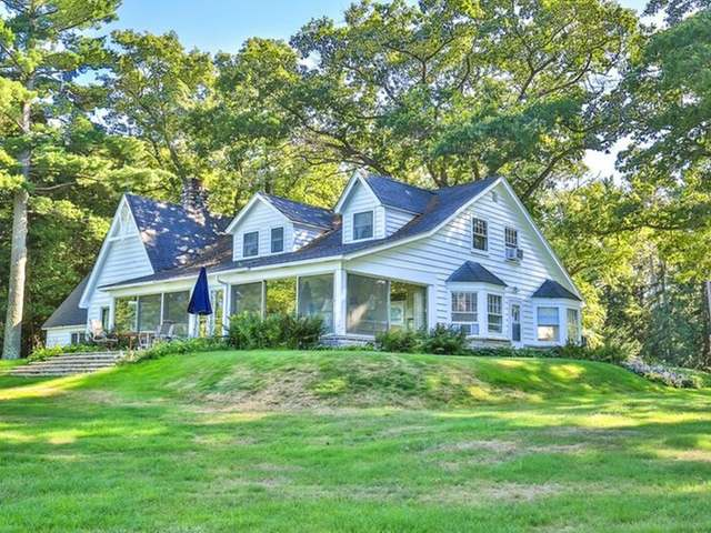 A true yester year estate, the historic entrance offers 300ft of true stone & mortar fencing w/ profound workmanship. The grounds are spectacular w/ scattered towering trees, flower gardens & flagstone walkways. As you wind down the black top drive first comes the caretaker's home, the green house & additional garages, next the classic toy barn & previous stables. As you approach the main lodge you have the garage, a charming guest cottage, bunk room & a fish cleaning facility. The lodge offers elegant wood work w/ vaulted and beamed ceilings, an open concept layout w/ 2 fireplaces. The waterfront will amaze you w/ sand frontage & crystal clear water. Did I mention the 1st boat house w/ a party deck or the 2nd boat house w/ an open concept, enclosed party room and fireplace w/ 3 walls of glass? The 600 sq. ft. lakeside flagstone deck and decorative fieldstone wall runs the length of the water front. This is a rare find, a true historic Northwood's Estate.