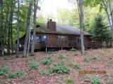 This Cisco Lake Chain Getaway has it all. This 3 bedroom 2 bath chalet style home has level frontage, Northwood's charm and privacy. This year round gem is in excellent condition and ready to move in. Features include a fieldstone wood burning fireplace, 3 season glassed in porch and panoramic views of the Cisco Chain. This is the best buy on the Cisco Chain in todays market.