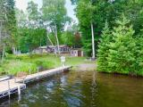 Charming 3BR 1BA year-round home on Pokegama Lake of the Fence Lake Chain. It's hard to check all the boxes when finding a home but this one surely does. Property features level approach to lake with sandy beach & great swimming frontage. There is a private peninsula with a navigable waterway creating a great buffer for privacy w/ unobstructed lakeviews. A recent addition was finished for a large den & mud/entry room on each end of the home. No details were left out in the den which features panoramic lake views, knotty pine accent walls, cathedral ceilings, & gas stove fireplace. In addition there is an open concept kitchen w/ dining area. Many updates - New plumbing, gas water heater, furnace ,and roof. There are 2 large garages, one being a 32 x 24 heated workshop at water's edge as well as 36 x 12 garage behind the workshop with separate entrance. Pokegama Lake is located on the 10 lake Fence Lake chain featuring endless recreational activities and exceptional fishing.