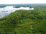 Large 10.13 acre parcel of wooded privacy! Located just south of Minocqua, this is a perfect opportunity to build your beautiful Northwoods home or use for a hunting retreat! Many trails have already been carved out and lead throughout the woods. The property is located just around the corner from 403 acre full recreational Bearkskin Lake which has a public boat launch and is home to many species of fish including musky, walleye, pike, bass, and panfish. Property also abuts to the popular Bearskin trail right out your back door which leads to downtown Minocqua for snowmobiling or other winter and summer fun! Located in the heart of the woods the outdoor adventures are endless here. Don't miss out on this opportunity!