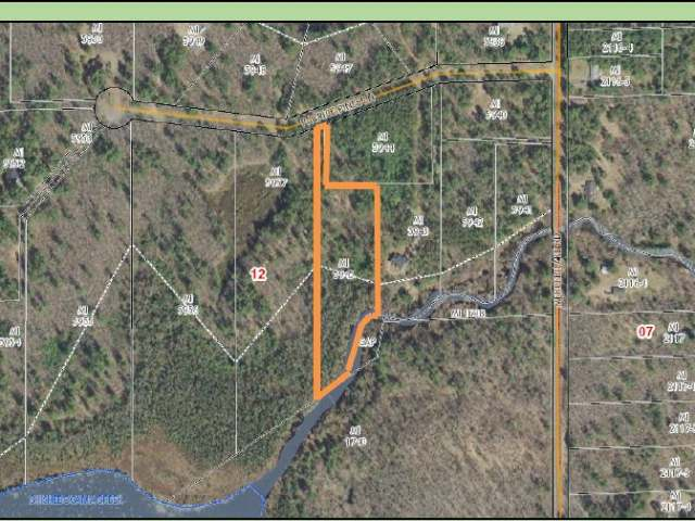 Forested residential/vacation south facing building site with 450+/- feet of meandering frontage on Shishebogama Creek. Wildlife galore. Fronting on a dead end (no through traffic) blacktop town road with buried electrical and natural gas. 3.29 acres, located about 5 minutes west of Minocqua. Easy year round access. Wonderful wilderness views. Possible owner financing.