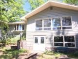 Beautiful home on crystal clear Diamond Lake. This home has been totally redone from top to bottom. New kitchen, carpeting, roof, septic, drywall. Property has 180.45' of frontage . Diamond Lake is 40' deep and 115 acres. Fish include Musky, Panfish, Largemouth Bass, Smallmouth Bass and Walleye. Lot 5 with cottage also available!