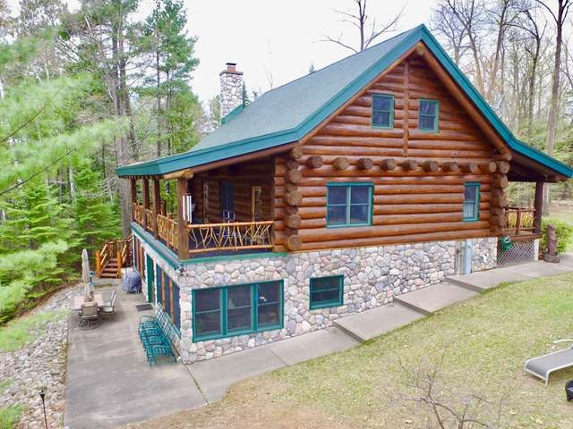 White Sand Lake is one of the premier stand-alone lakes in Vilas County and encompasses 1,181 acres of crystal clear water and recreation. This property features a 3 BR, 3 BTH, full log home with beautiful exterior stone and large 24x 37 detached garage. Inside the garage, you will find upstairs storage and a winch system to move large toys up and down to maximize winter/summer storage space. In the home, you will be overwhelmed by the large white pine logs and Northwood's charm on all three levels. The main floor offers a master and guest quarters along with a grand front entryway leading to the large loft that offer 2 designated sleeping areas & full bath to host big groups and overnight guest! The field stone fireplace and kitchen on the lower level will undoubtedly be the stage for your family entertainment, offing easy walk out to the lake and screened-in patio. Come see this Northwoods dream cabin today!
