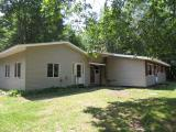 OPPORTUNITY KNOCKS! Here is a great privacy parcel with four plus acres of wooded land in a great recreational area. The home is open concept with cathedral ceilings in the living area. There are three bedrooms, two full baths and a den currently but this property does have a 4 bedroom septic system! There is a two car garage and sheds for storage. A nice firepit is tucked in the woods for those summer evenings. A great location between Eagle River and Rhinelander. Don't miss this opportunity!