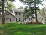 "This Colonial home is positioned on 2 lots in the prestigious Timber Ridge Golf Community in Minocqua, Wisconsin. Elegant foyer graced with an open staircase to upper level where you'll find 3 BR and 2 full BA including the generously sized master suite w/walk-in closet, tile bathroom, double sink vanity, whirlpool tub. 2 BR share ""Jack n Jill"" bath. Main floor offers a dining room, den with 2-way fireplace shared with living room, large kitchen with built-in bar, center island & breakfast nook. Great deck off living room & kitchen for easy outdoor entertaining & the 24 x 34 great room is ideal for indoor entertaining, powder room BA & laundry. Finished, walk-out lower level offers a family room, exercise and/or hobby room. Att. 2 car gar. Timber Ridge offers a privately owned 18-hole public golf course, fine dining, swimming pool, easy access to snowmobile trails, Bearskin Trail & many area lakes. Just a few minutes to all conveniences in Town & even closer to MHLT grade school."