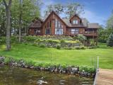 Lake Tomahawk property on the western shoreline in Minocqua. 3,900 sq ft home with towering lakeside windows &150' of level sandy frontage. Built in1998, features 4BR, 3.5BA, main level master & laundry rm, fieldstone FP, lakeside screened porch, & a walkout basement. In addition, this property offers a blacktop driveway, 3 car heated garage w/ add'l 3 car non-heated garage, and a new roof. The property's location makes for a short navigable trip to either downtown Minocqua or the city of Lake Tomahawk. Enjoy many restaurants & attractions the Minocqua chain has to offer. This property has been in the same family for 36 yrs & offers tranquil privacy.. The approach to the property will take you through the Pottawattomie Forest Conservatory Land which encompasses approx. 500 acres of towering mature forest. This property is part of The Pottawattomie Colony that was created in 1939 & carries unique Minocqua area history. The colony members also share private hiking/biking trails.