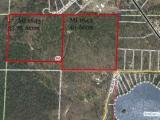 Level and forested large acreage tract about 8 miles west of Minocqua that would be ideal for a multitude of ventures. Quality residential subdivision, privacy estate. Very recently rezoned from District #1A to District #15 Rural Residential. zoning would allow for private livestock. It's an impressive forest with trails and wildlife galore.