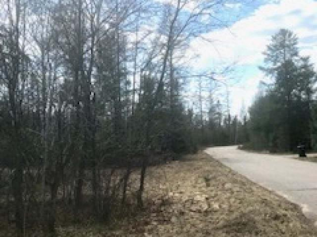 Buildable country wooded lot with electric at Lakewood rd. Come build your northwoods home with 5.03 Acres located in between Rhinelander, Minocqua and Tomahawk just minutes off Hwy 51. The land is rolling mostly open with large pine trees lining the road. Perfect spot for horsed, large gardens, or small hobby farm.