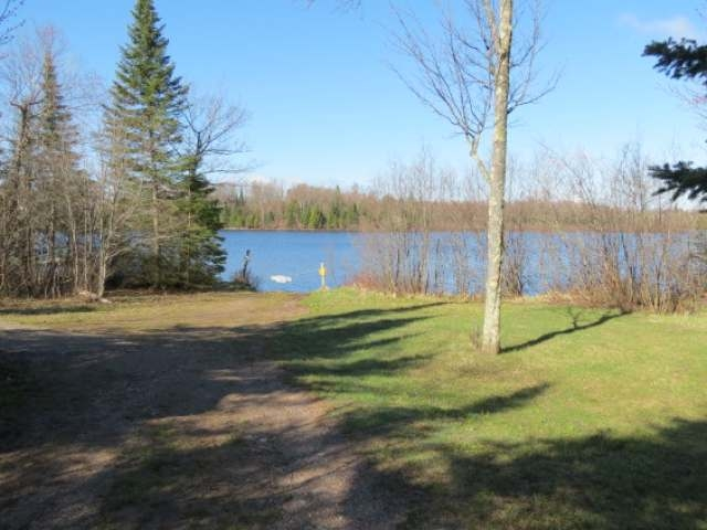 Large Lot located on a dead end road with electric and telephone on both roads and Deeded Access to Rainbow Lake. This is a 6.5 acre lot with 1/3 interest in a deeded access lot located approx. 500' away. There is 118' of frontage along with a pier and fish cleaning house. Located close to snowmobile trails, cross country ski trails, hunting and fishing on Rainbow Lake which offers Muskie, Northern Pike, Walleye, Largemouth and Smallmouth Bass and panfish. Boat Landing is close to property. Great Buy, Great Investment!
