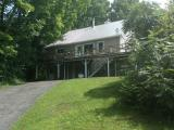 282 acres of pure enjoyment! With 200 ft frontage on Fay lake can offer you boating/canoeing/fishing/bird watching/and most of all tranquility while sitting on the wrap around deck. 3 plus bedroom /2 1/2 bath. Large dining/Living room with Stone, wood burning fireplace. Enclosed porch over looking the lake. Home offers multiple rooms for extra sleeping/office/game room areas. Kitchen and Bath are located also on main floor. Upstairs huge Master bedroom with large bath/walking in closet and several other storage closets/Laundry hookup with Breathtaking view facing the lake. Basement area has 1 car garage, 1/2 bath, several storage rooms. With little over 1 acre possibilities are endless. Use it as weekly/monthly rental to help pay that mortgage, whatever you choose you wouldn't be disappointed. Start making memories with your family. (Seller will consider a land contract. Several lots available size 50 x 150)