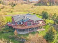 Commanding sixty mile views, 111 acres, 2 homes, barn, & even a runway! Built in 2006, the luxurious 3br/2ba open concept main home boasts cathedral ceilings, hickory cabinets, toasty in-floor zoned heat, fenced yard, large open kitchen w/island, finished walkout basement, wet bar, huge family room, 2-car attached garage, plus a fireplace & exterior facade made of stones sourced from the property. The manufactured 3br/2ba 2nd home includes a big master bedroom, spacious open floor plan, and a fully insulated block foundation. The hillside 67'x39' 2-level barn features a metal roof, doors wide enough for an airplane, 4 horse stalls, tack room, electricity, running water, & ability for both levels of the barn to be accessed from outside. There's also 10 acres of pasture, grass runway, 15-cord woodshed, & even an RV site w/full hookups! The possibilities are endless, the sellers are anxious for offers, & this move-in-ready ponderosa is priced to sell!