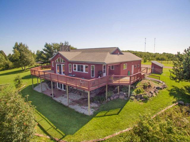 Commanding sixty mile views, 111 acres, 2 homes, barn, & even a runway! Built in 2006, the luxurious 3br/2ba open concept main home boasts cathedral ceilings, hickory cabinets, toasty in-floor zoned heat, fenced yard, large open kitchen w/island, finished walkout basement, wet bar, huge family room, 2-car attached garage, plus a fireplace & exterior facade made of stones sourced from the property. The manufactured 3br/2ba 2nd home includes a big master bedroom, spacious open floor plan, and a fully insulated block foundation. The hillside 67'x39' 2-level barn features a metal roof, doors wide enough for an airplane, 4 horse stalls, tack room, electricity, running water, & ability for both levels of the barn to be accessed from outside. There's also 10 ac of pasture, grass runway, 15-cord woodshed, & even an RV site w/full hookups! The possibilities are endless, the sellers are anxious for offers, & this move-in-ready ponderosa is priced to sell!