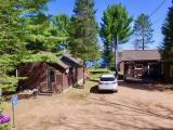 This Rustling Pines Condominium on Lost Lake is an excellent opportunity to be on a renowned fishery with very level and sandy frontage. The property features 1 BR, 1 BA, a loft, a single detached garage, a fish cleaning house, a beach, a playground and extra parking across the road. Conveniently located just North of St. Germain, this condo has a great location for any Northwoods activity or event you may want to attend. Additionally, this cabin is year-round and has very reasonable monthly dues that cover much of the maintenance. Schedule a visit today