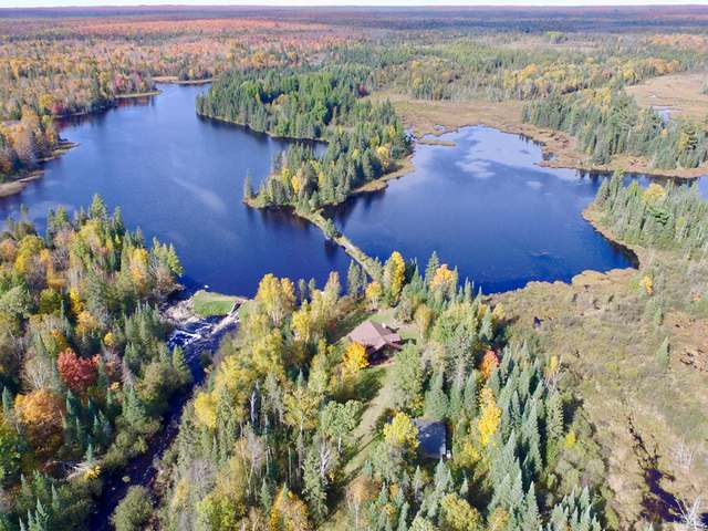 This exclusive lake retreat and acreage, known as Forest Wonder, offers the ultimate privacy and tranquility for the outdoor enthusiast. The amazing 342-acre wildlife sanctuary has moose, wolves, bears, bobcats and lynx. You will also see Swans that return year after year in addition to many other migrating birds. Home features 2 BR 2 BA with beautiful pine accent and cathedral ceilings throughout. There is a very deep 2 car garage for storing all your toys and boats. This property offers its own 60-acre lake with additional ponds and has a dam that is registered as a low risk with a rock spillway, which creates a continuous sound of cascading water that can be heard from your 1,550 sqft fully equipped year-round lodge. Current owner has stocked the lake with walleye and pan fish for the past 4 years. Other species found here include northern pike & bass. Don't miss the incredible opportunity to own this piece of paradise.