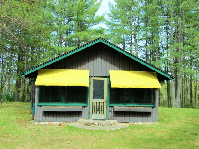 This true Northwoods nostalgic cabin on Trout Lake is hitting the market for the first time. Do not miss your opportunity to live on the most desirable, 3,816 acre, Trout Lake. With Caribbean sand frontage, crystal-clear water and endless fishing there is nowhere else to enjoy your summer. The home offers all Northwoods charm with cathedral ceiling, extra-large lake side windows, a grand field stone fire place, 3 bedrooms and the perfect screened in porch. With over 4 acres of beautiful land and privacy you can enjoy the cabin as your summer retreat or use the large parcel to build your dream home and maintain the cabin for your charming guest cottage. Parcels like this on Trout Lake are a rear find. This is an absolute must see.