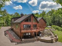 How about end of road privacy, 8 ac of tranquility, 310' Chaney Lake sandy frtg, executive home w/touches of luxury & a rare wilderness view? This 4 BR/2 BA chalet has it all. Main floor master w/WIC. Mbath has jetted tub, dbl sink, quartz, & superb tile shower. Main floor laundry, 4th bed/office, & walk-in pantry. Great room boasts soaring ceilings, full height stone FP, double island kitchen, quartz, SS, & wall of west facing windows for spectacular sunsets. Not another dock in sight! You'll love the warmth of the loft family room w/game nook facing lake. Two large BRs, full BA, cozy reading area finish upper floor. Att. oversize 2 car w/huge storage loft. Unfinished basement (stub for full BA) w/high ceilings & lake facing glass walkout to a patio/fire pit. Shop is 2 story, finished, heated, set up for woodworking w/spray booth! Level approach, roll-in dock, generator, even a top-to-bottom dumb waiter! Pride of ownership evident in this immaculate, tastefully appointed home.