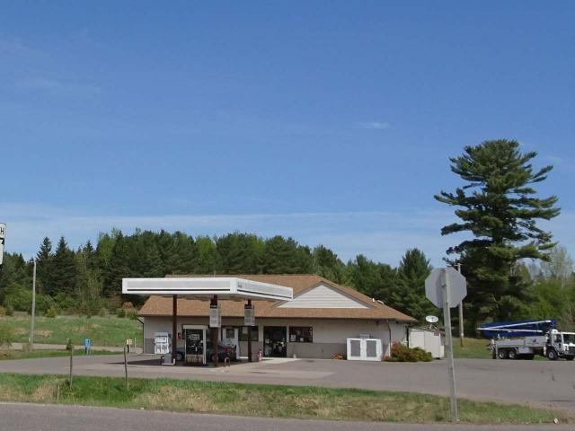 The Trifecta of Opportunity! Fifield Station, EZ Storage and loads of development land. Well established convenience store located on the ATV and snowmobile trails, across the road from the community riverside park on Hwy 70 and just before Hwy 13 intersection. Store offers loyal employees, air machine, self serve, credit card gas, car diesel, semi diesel, and off-road/heavy equipment diesel pumps with easy entrance and circle drive exit for long, tall or big sizes. Snacks, food, refreshments, fresh coffee, beer, wine, liquor, ice, propane, bait, tackle, fishing licenses, lottery, ATM, automotive, etc. Ten storage units (8)10x26 and (2)13x29 with 10x10 doors. No issues keeping them rented and requests for units all the time if you want to build more. Metal roof, concrete floors, electric and low maintenance construction. Large gravel parking area has income from UPS, campers, car, truck or semi parking. Elevated acreage behind would be great spot for duplexes or owners private home.
