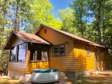 This Squirrel Lake cottage is the perfect place for your getaway up north. The 2BR, 1BA with 118 Feet of sand frontage on Squirrel Lake comes with 1.3 acres, 1 pier and western-facing views. Minutes from town, this property is close to all the shopping & entertainment associated with Minocqua while also providing the isolated nature of Squirrel Lake. Recent improvements include kitchen appliances and a new roof. This property may also be purchased as a package with the Squirrel Lake Island property.