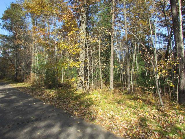 Looking for the perfect home building site with lake access but without the lake-front taxes? This nicely wooded, 1.6-acre lot is close to town for convenience, but is in a quiet, private area. The lot includes deeded access to 76-feet of sandy shared access to 716 acre Shishebogama lake known for its fishing & full recreational opportunities. There are nice, level building sites and utilities are readily available along Crescent Drive, a paved town road. Local recreational activities include fishing, hunting, biking, & hiking, hundreds of miles of groomed snowmobile trails & several golf courses. Launch your boat or swim at the deeded access or just enjoy the quiet and abundant wildlife while shopping and all the conveniences of the Minocqua/ Arbor Vitae/Woodruff area are just minutes away. Whether you plan to build your year round home or vacation get away, this lot is a value at only $24,900!
