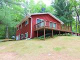 AFFORDABLE LAKE SIDE LIVING!!! This 2 bedroom, 2 bath condo offers spectacular view on Little Arbor Vitae. With an open concept living room, dining room and kitchen there is plenty of space to entertain. Enjoy the evenings on your large open deck or cozied up by the wood burning stove. The partially finished basement offers additional living space, the second bathroom and the washer and dryer. The extra long one car garage is perfect to keep you out of the rain. Make this year round, lake front cabin your own lake home or invest in it as the perfect rental property.