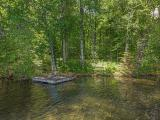 Make your Northwoods dreams come true on this premium 1.63 acre parcel on exclusive Carlin Lake! The approach to the water is mostly level, there's a gentle slope for a walkout basement design, and this well wooded property has no lowland. Carlin Lake has no public boat landing, sparkling gin clear water, excellent fishing, and is big enough for full recreational use but small enough to be peaceful and quiet. The 200' of sandy frontage begs you to dip your toes in the water. A gentle trail leads to the waterfront and a PERC test done for a Mound septic system. Opportunities to get on this incredible lake are few and far between. Come take a look today before it's gone!