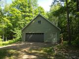 PRICE REDUCED! - This is truly a must see! This off water lot offers you 2.79 acres with a New 28x30 Garage with loft. Has a force air furance, With a drilled well and pert test was completed for a conventional septic.. Sellers also cleared a spot to build your Cabin. What more do you need? Your only steps away from the best fishing and Casino's around. Come and take a look.