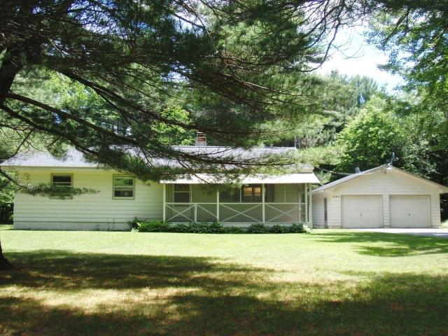 Bloom Rd. 3 bedr. ranch home. Home has been vacated and cleaned to perfection. Carpets have been cleaned and some are new. There is a lovely wooded lot one mile from Eagle River. Firepit in the backyard. First floor laundry with newer washer and dryer. Kitchen has stove and refrigerator included. Dining room has built-in corner hutch with glass doors. Spacious living room room with large windows. All bedrooms have double closets. The bathroom is spacious with tub and shower and in laundry room there is an add. closet toilet. A full basement offers lots of storage space. The driveway is blacktopped and a two car garage affords more room for toys or vehicles. This one is standing tall! Vacant and ready for easy showings.