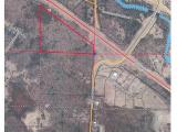 21.47 acres of land with great visibility at the intersection of Germond Rd and Highway 8/17 bypass. Property is zoned general use and is located in an area with commercial development, lending itself to many possibilities. Land is mostly high ground and treed with Maple/Oak. Smaller commercial lots available off Taylor Dr.